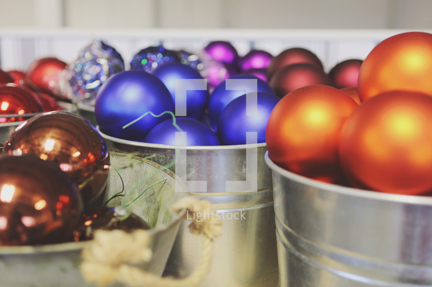 Christmas ornaments in buckets