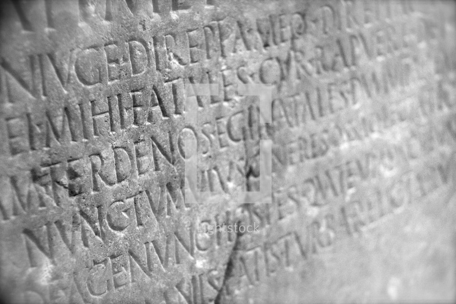 Roman Latin wording carved into ancient monument