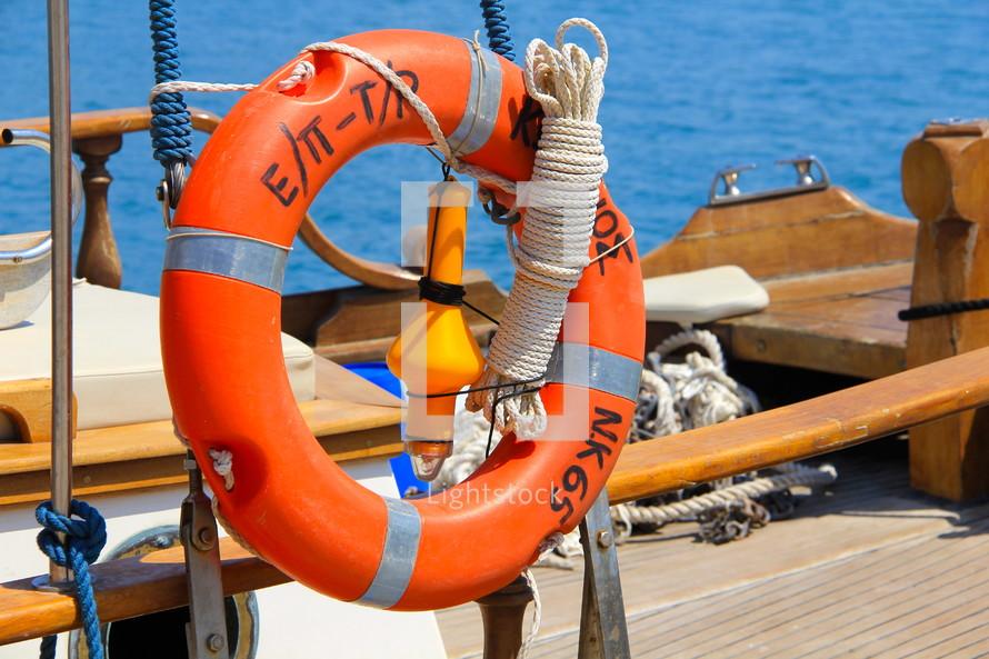 life ring, life ring or lifesaver ring on a Greek fishing boat