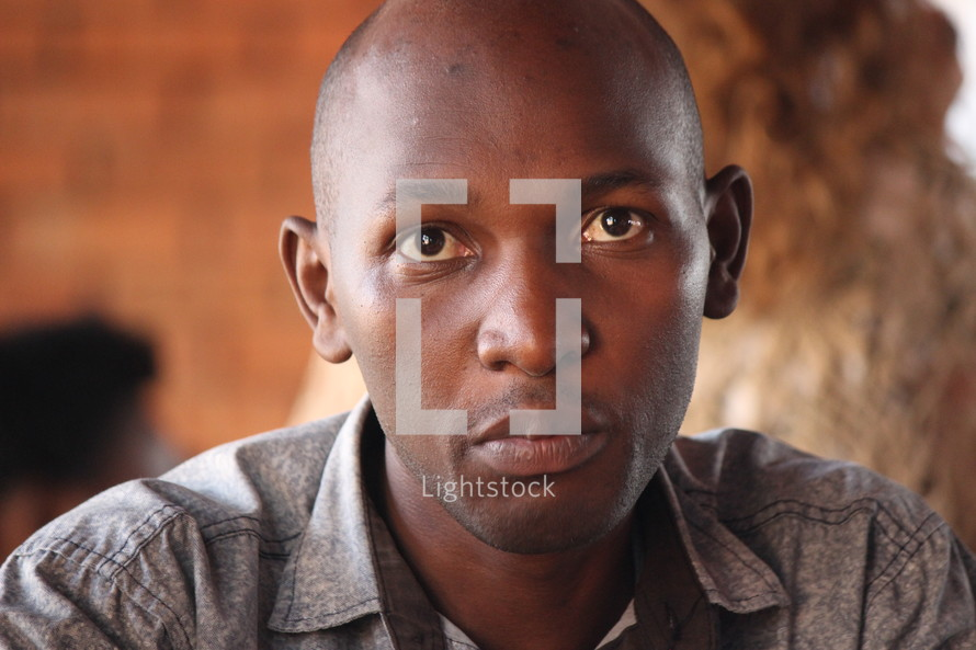 stoic face of a young African American man
