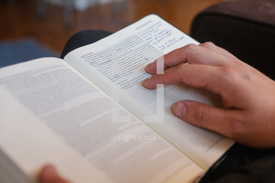 a man reading a Bible in his lap