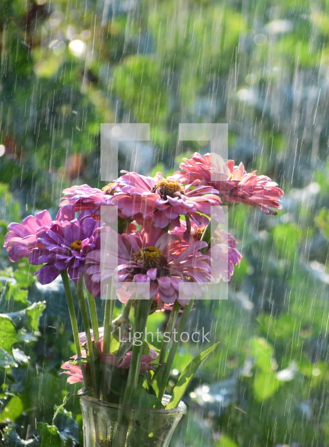 rain falling on a vase full of flowers