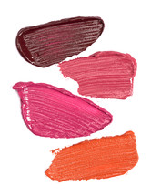 Abstract background - Four Shades of Lipstick and Lip Gloss Swatches Isolated on a White Background
