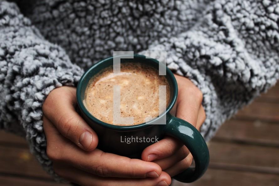 warming hands on a mug