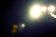 looking up at stadium lights at night