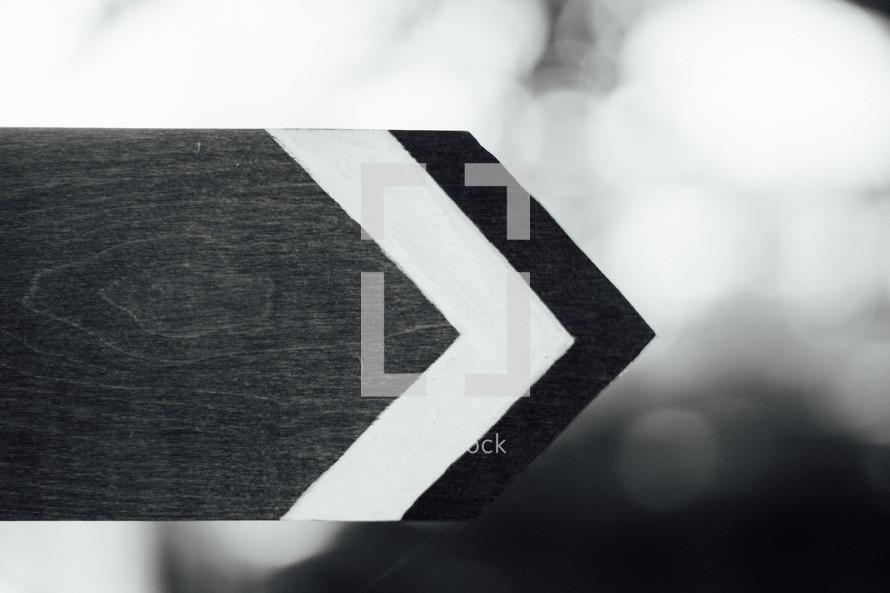 wood cut into the shape of an arrow
