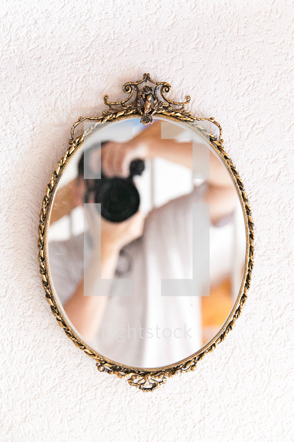 mirror reflection of a man taking a picture
