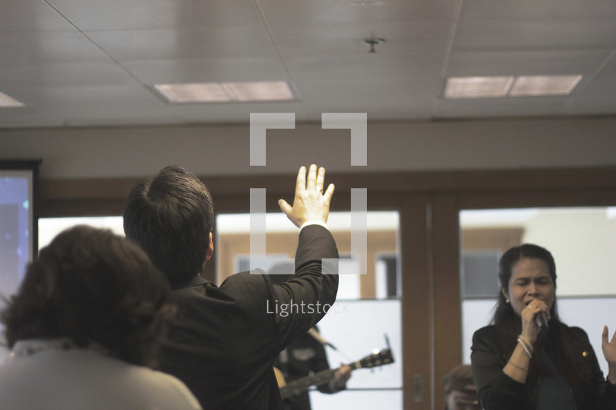 hands raised during a worship service an worship music