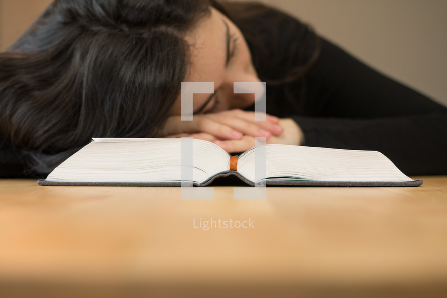 a woman sleeping on the pages of a book