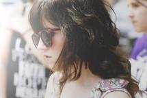 head shot of a teen girl in sunglasses