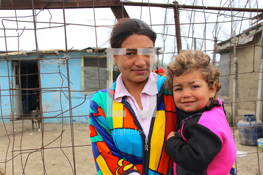 Romanian Gypsy mother and son in a poor village {Also try search for 'Ethnic Faces'}