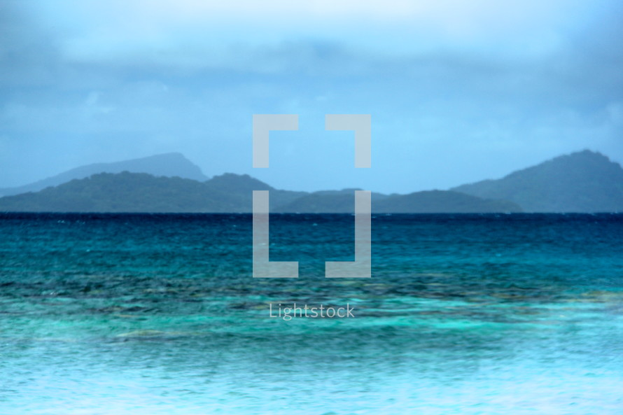 Misty island mountains and tropical waters