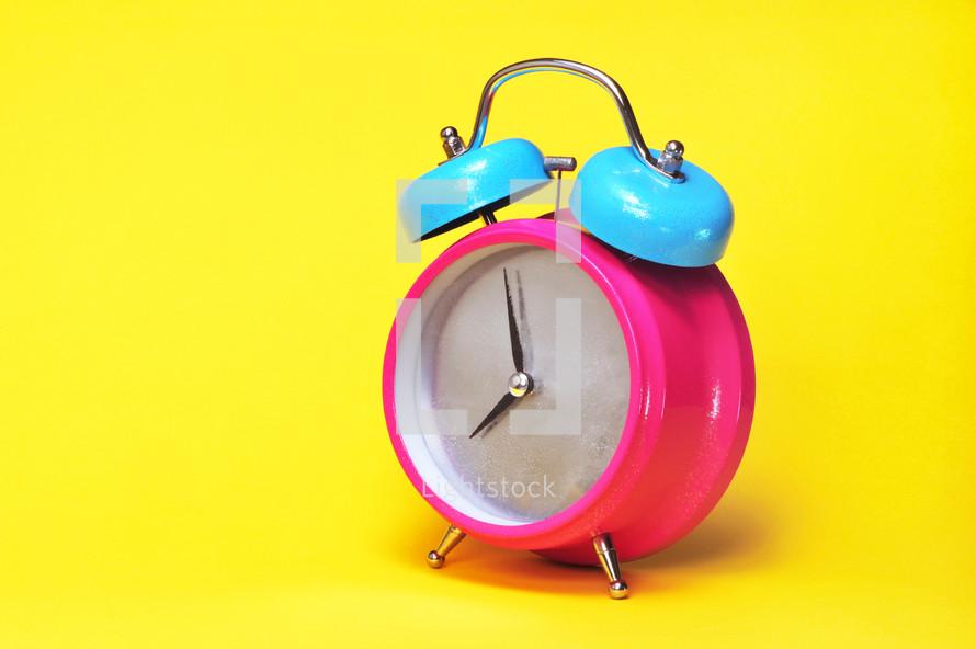 Pink alarm clock.