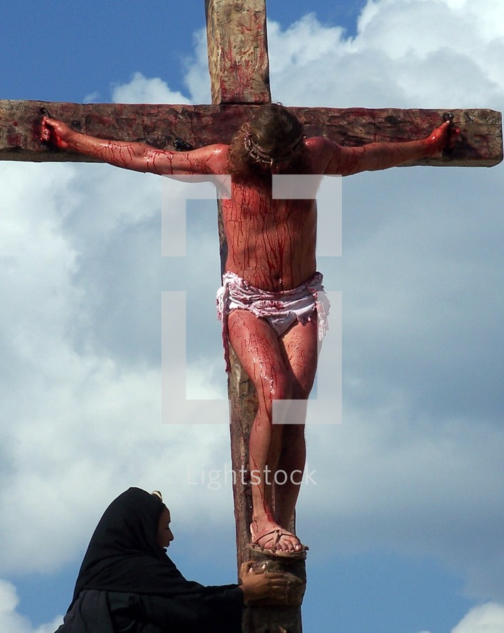 Mary weeping at the feet of Jesus at his crucifixion on the cross at Golgotha, the place of the Cross.