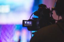 a man behind a video camera