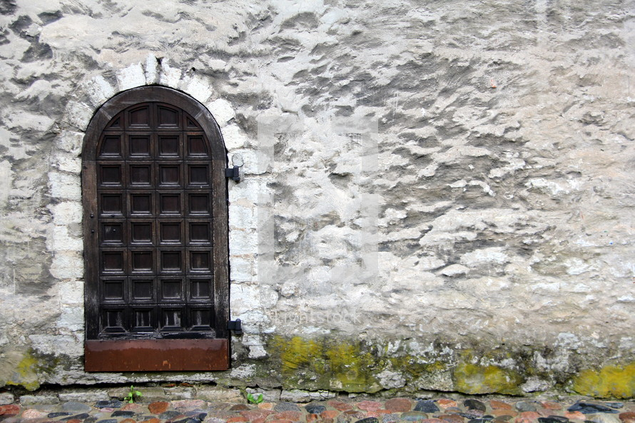 arched door on stone wall