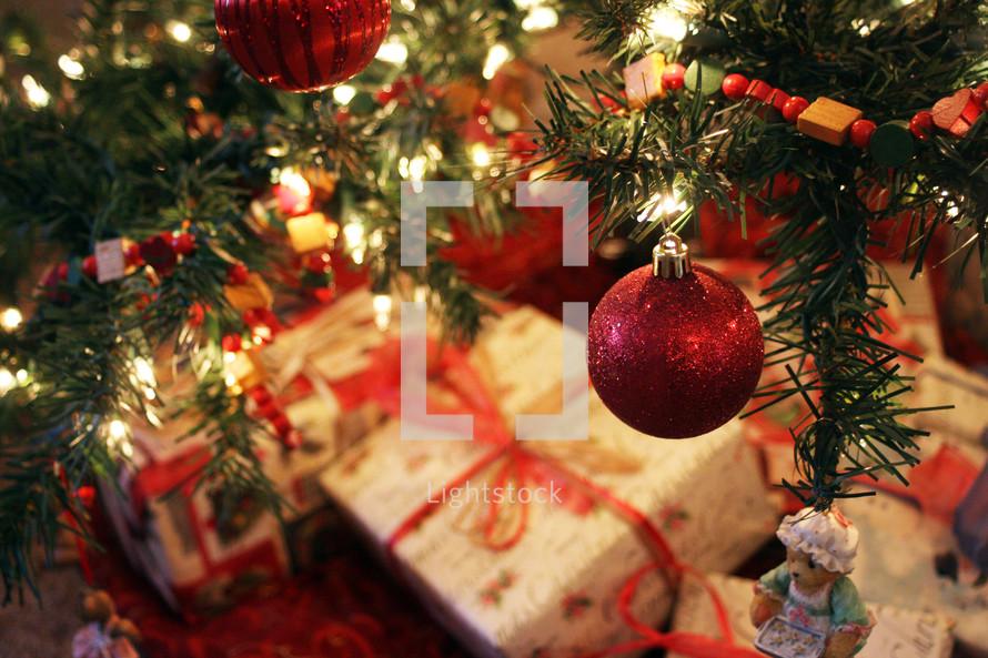 Christmas presents under a Christmas tree