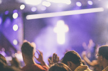 hands raised at a worship service