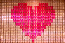 Red heart shape made from stacked communion cups