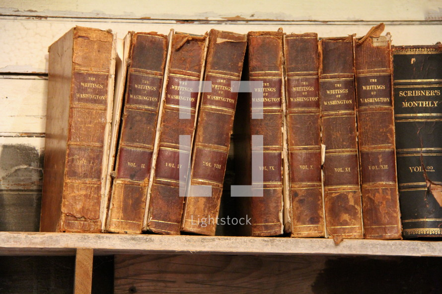 row of antique books on a bookshelf