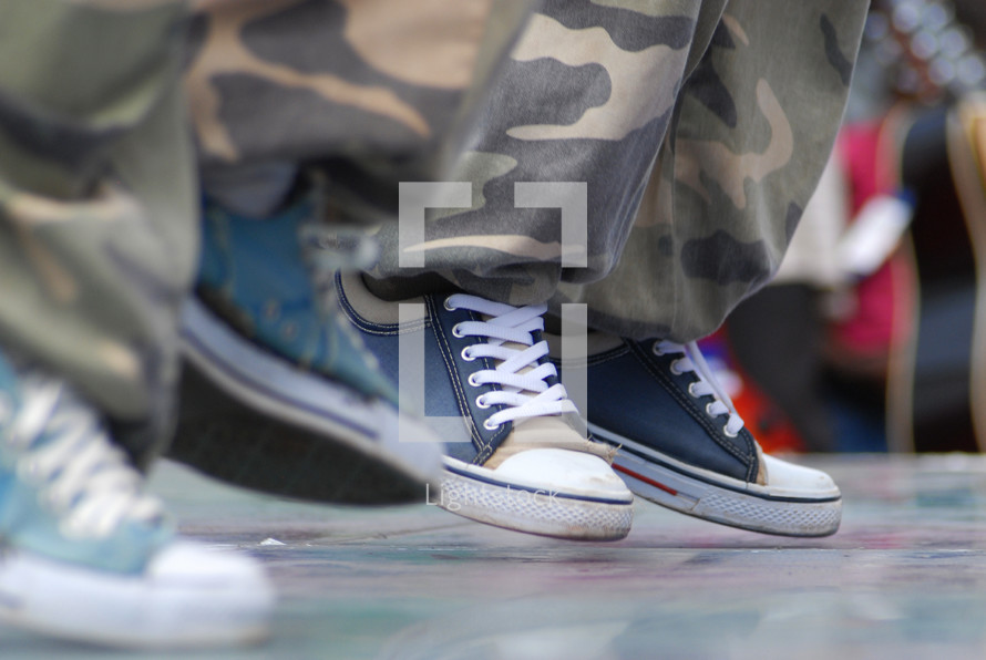 sneakers and camouflage pants