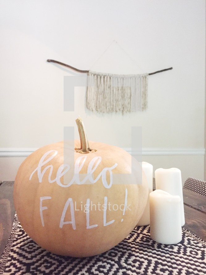 hello fall centerpiece on a dinning room table