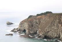 sea cave and cliffs along a shore