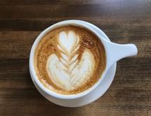 heart shape creamer in coffee