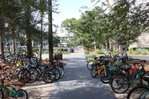bikes parked everywhere along a sidewalk
