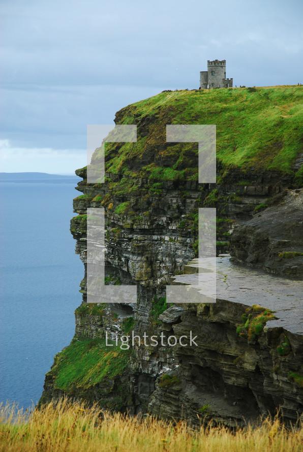 Castle on an ocean side cliff.