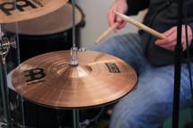 a man playing a drum set