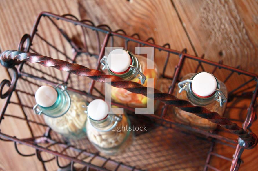 glass bottles in a metal basket