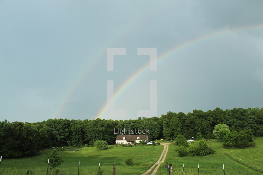 rainbow over a rural countryside