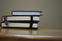 stacked books and journals