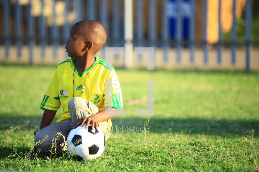 Little boy with soccer ball