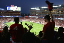 cheering fans at a soccer game
