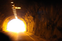A tunnel with a bright light at the end.