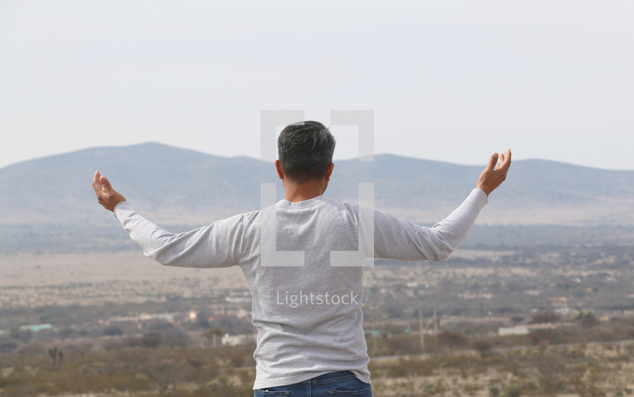 a man with outstretched arms