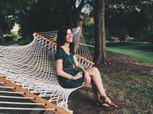 woman sitting on a hammock