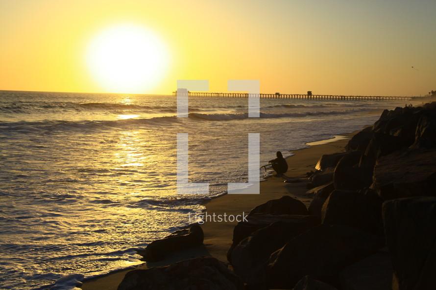 sunset over an ocean pier