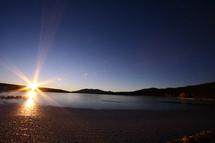 sunburst over water
