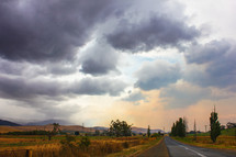 cloudy sky over a rural road