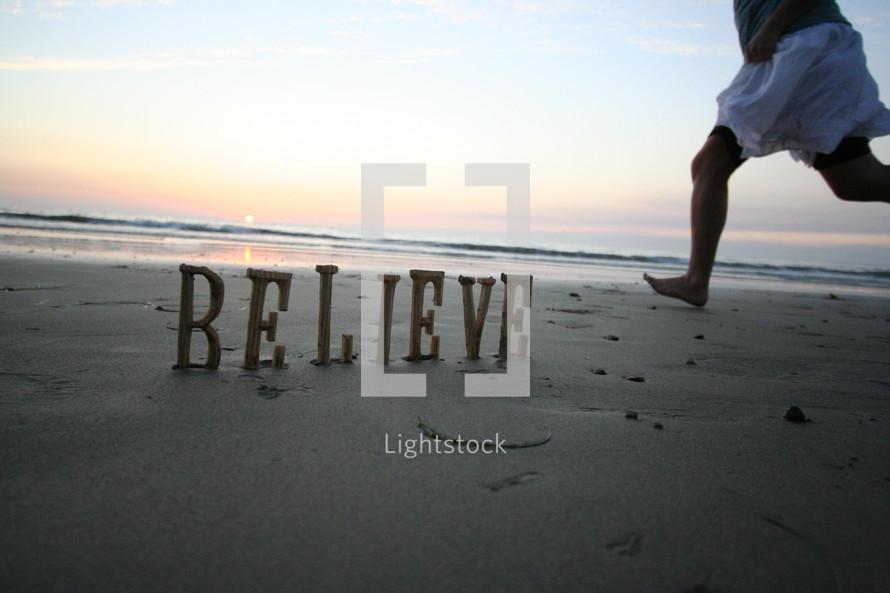 Believe written in the sand