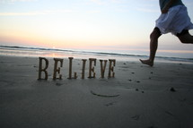 Believe written in the sand