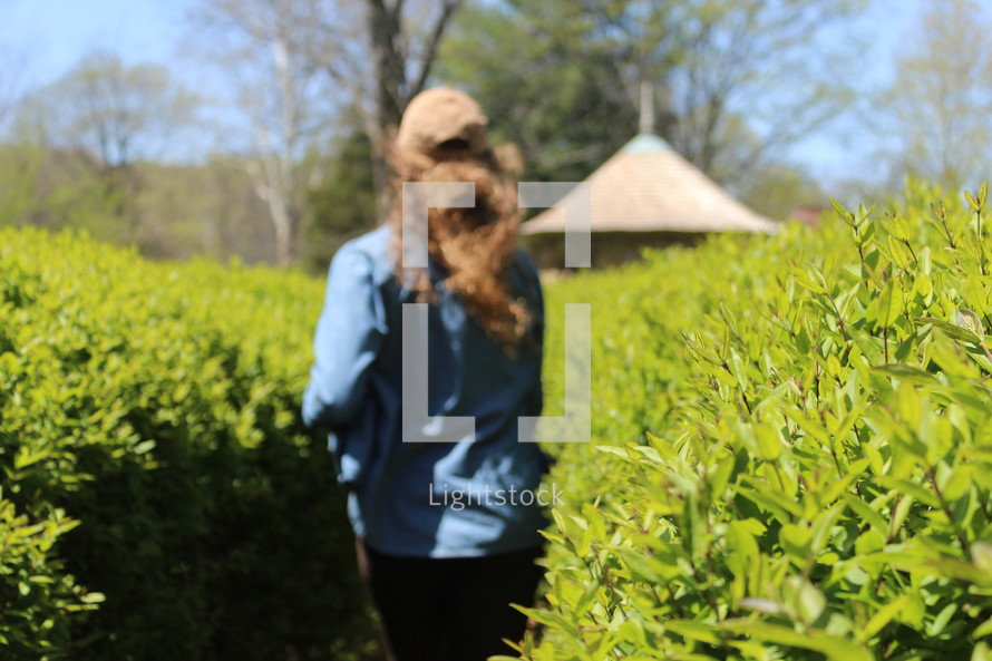a woman running through bushes