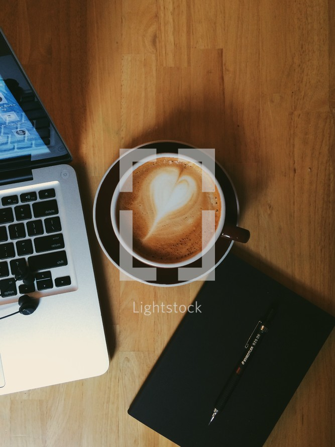 laptop computer, cappuccino, journal, and pen