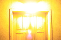 Sun beaming on a closed wooden door