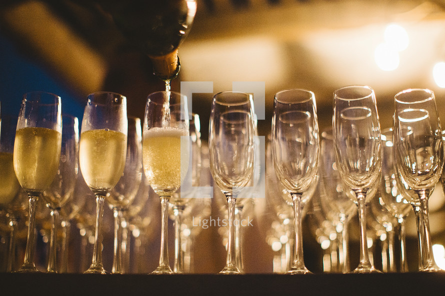 pouring champagne at a wedding reception