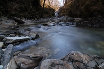 Misty creek with rocks at daybreak.