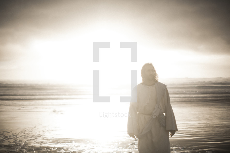 Jesus standing on a shore in bright sunlight